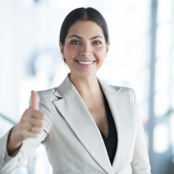 closeup-happy-business-lady-showing-thumb-up_1262-2980