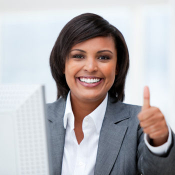 happy-businesswoman-with-thumb-up-working-computer_13339-4467